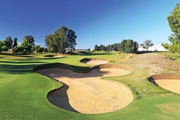 If the bunkers on Glenelg's 16th hole give you hell, you can wash it all away with a glass of Henschke's Keyneton Euphonium in the clubhouse.